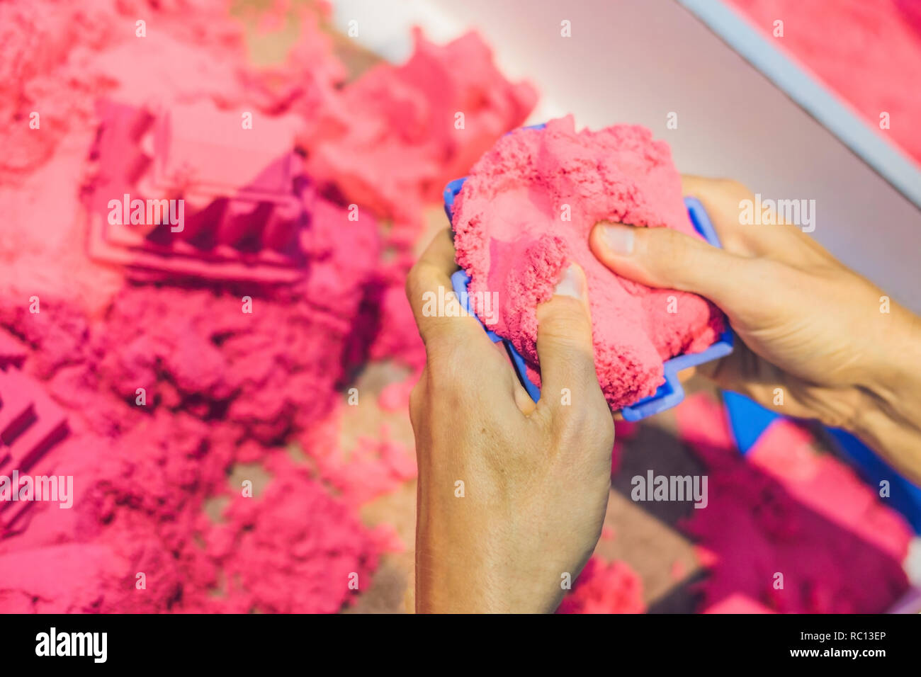 Boy playing with kinetic sand in preschool. The development of fine motor concept. Creativity Game concept - Stock Image