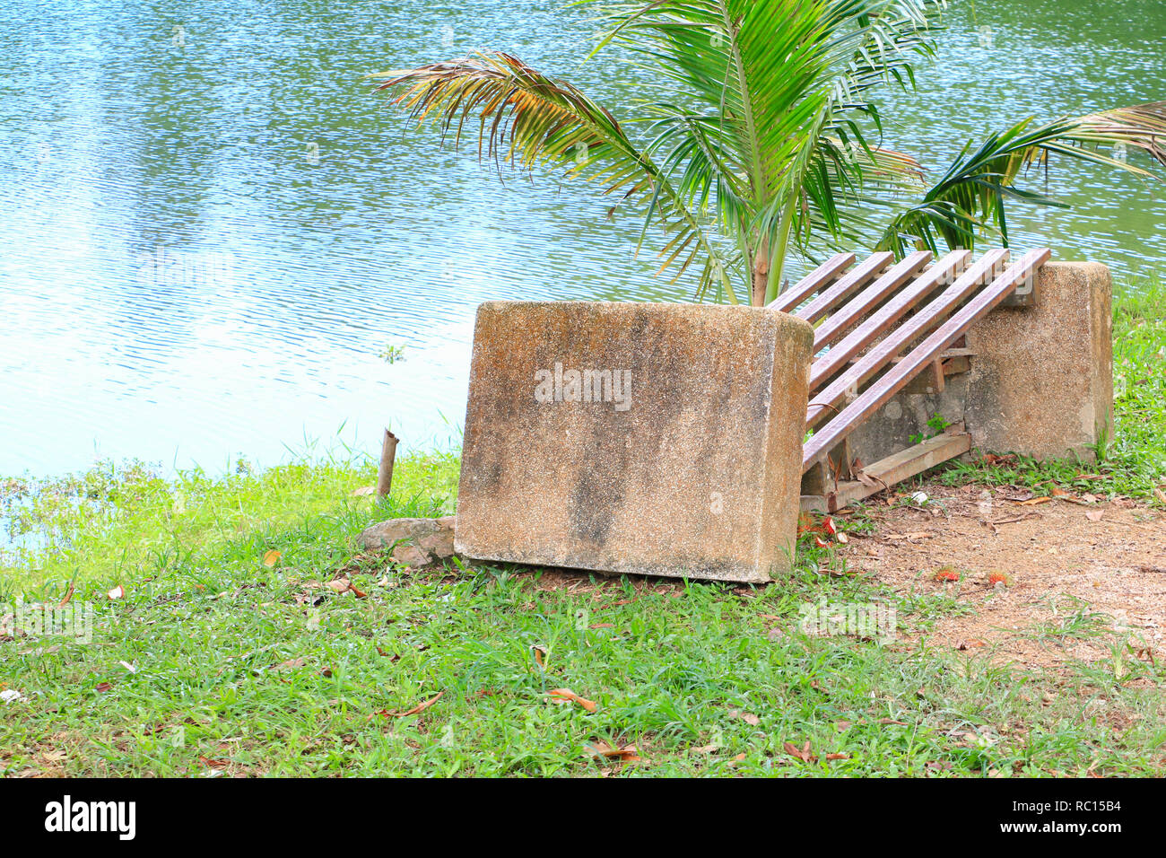 old chair deduct riverside in public park Stock Photo