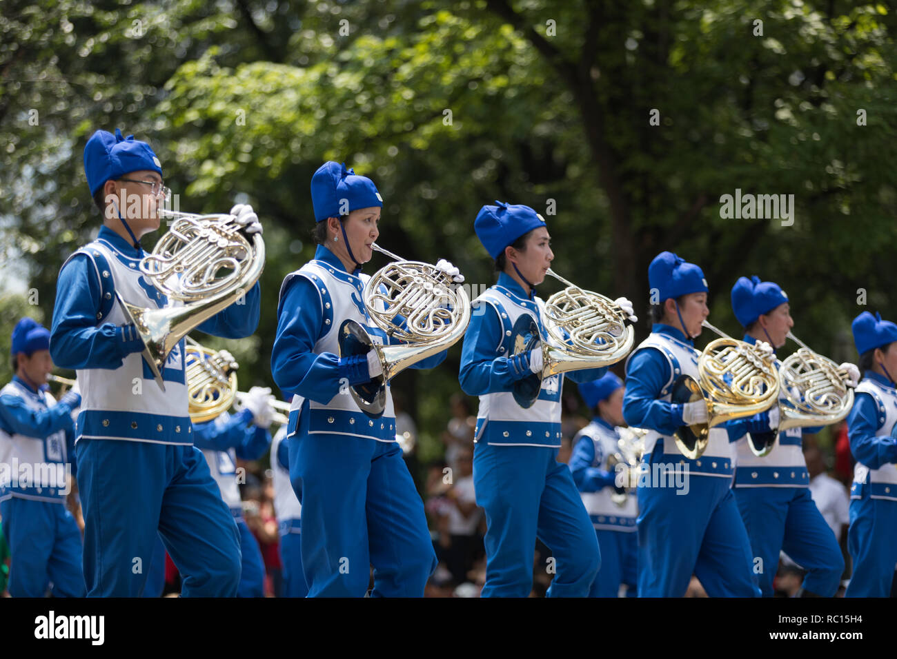 Washington, D.C., USA - July 4, 2018, The National Independence Day Parade, Falun Dafa chinese marching band, wearing traditional clothing, marching d Stock Photo