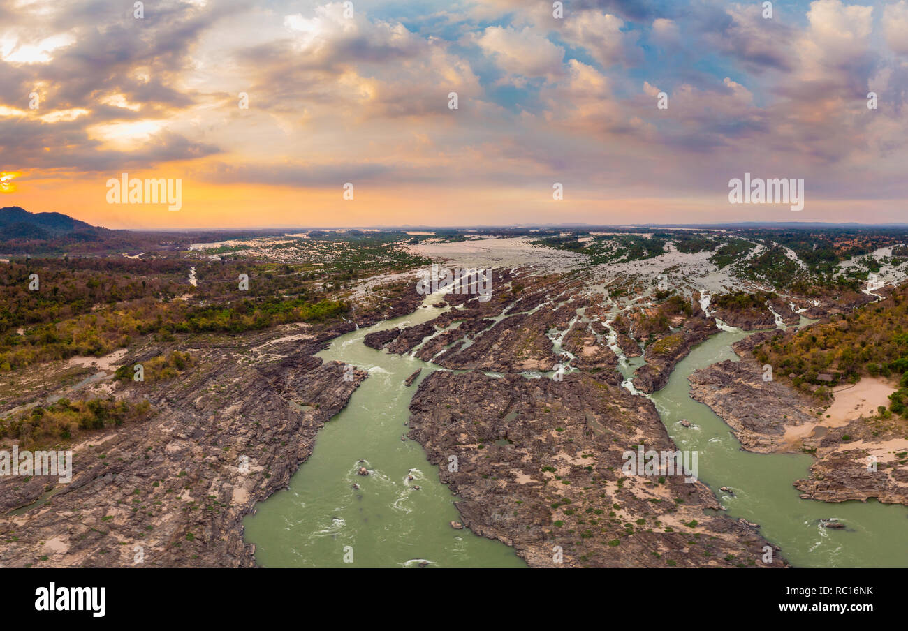 Aerial panoramic 4000 islands Mekong River in Laos, sunset dramatic sky, Li Phi waterfalls, famous travel destination backpacker in South East Asia Stock Photo