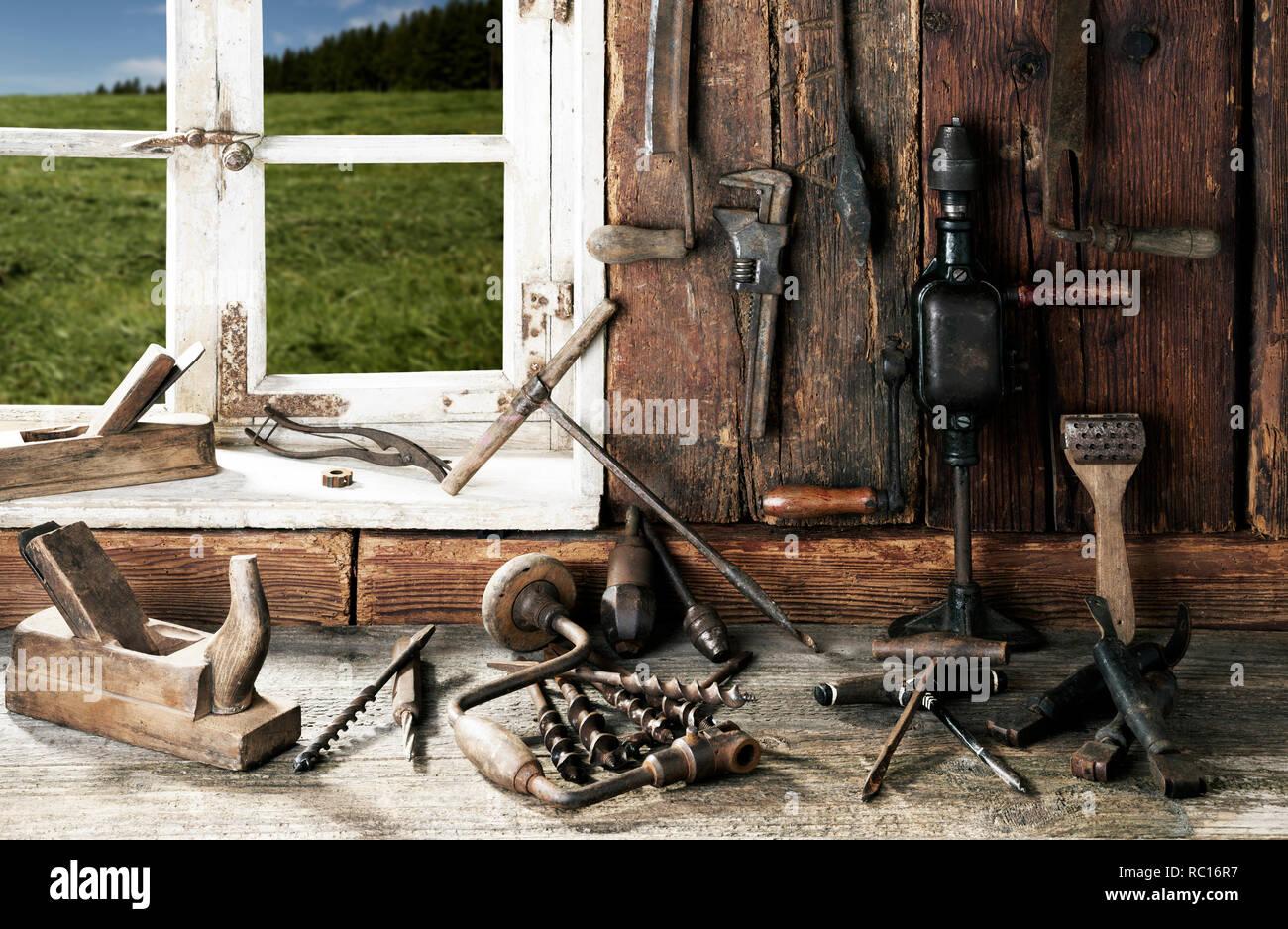 Vintage stylized old wood workshop interior - Stock Image