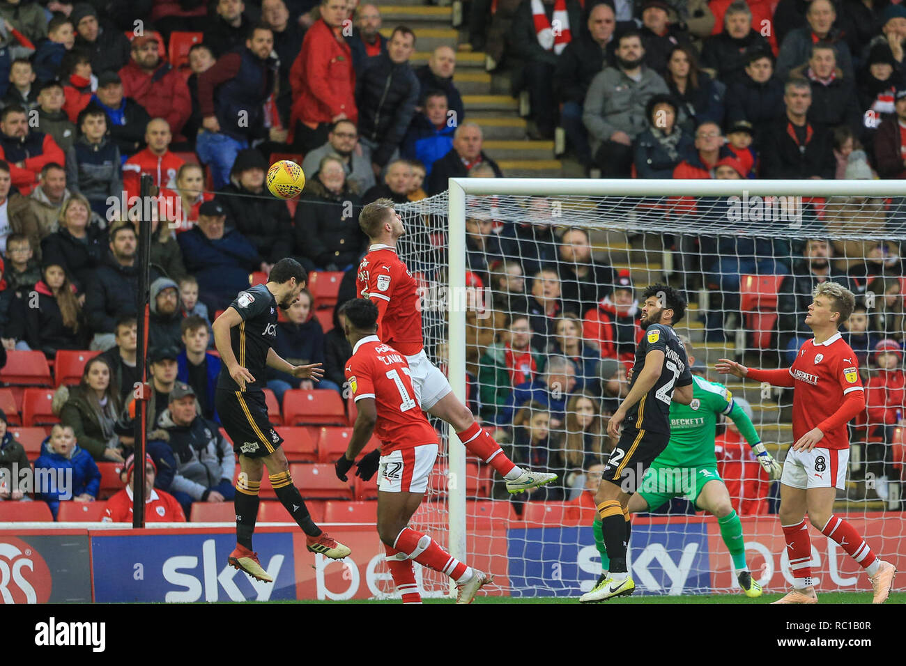 Barnsley, UK. 12th Jan, 2019. 12th January 2019, Oakwell, Barnsley, England; Sky Bet League One, Barnsley vs Bradford City ; Liam Lindsay (06) of Barnsley heads clear from a corner Credit: Mark Cosgrove/News Images English Football League images are subject to DataCo Licence Credit: News Images /Alamy Live News - Stock Image