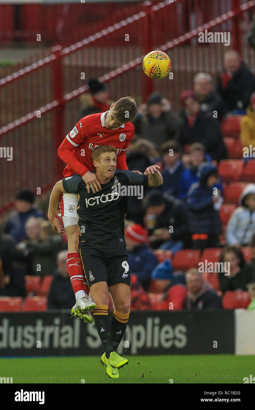 Barnsley, UK. 12th Jan, 2019. 12th January 2019, Oakwell, Barnsley, England; Sky Bet League One, Barnsley vs Bradford City ; Liam Lindsay (06) of Barnsley wins the header from Eoin Doyle (09) of Bradford City Credit: Mark Cosgrove/News Images English Football League images are subject to DataCo Licence Credit: News Images /Alamy Live News - Stock Image