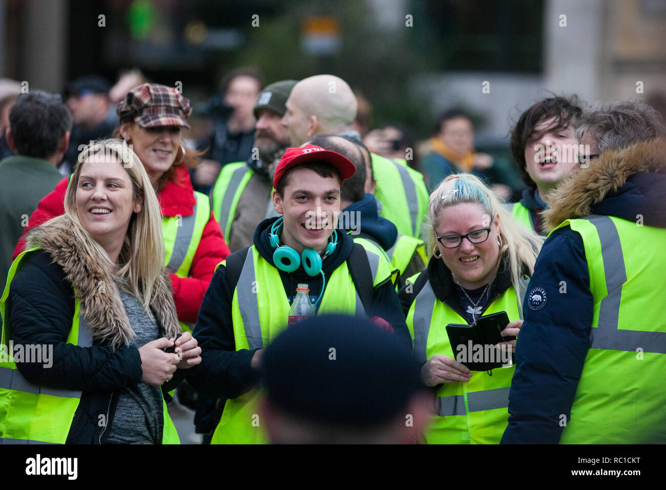 London, UK. 12th January, 2019. Max Hammet-Millay (c) stands among around fifty supporters of far-right group Liberty Defenders being kept apart by police from hundreds of protesters taking part in a 'Britain is Broken: General Election Now' demonstration organised by the People's Assembly Against Austerity. Some members of both groups were wearing yellow vests in solidarity with the 'gilets jaunes' in France. Credit: Mark Kerrison/Alamy Live News - Stock Image