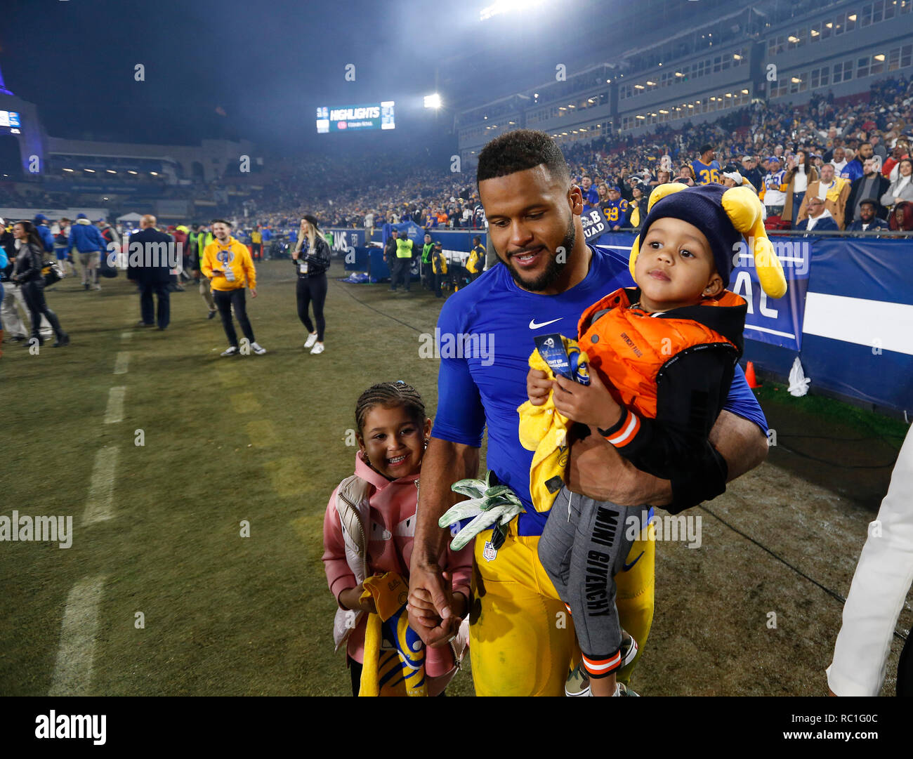 Los Angeles California Usa January 12 2019 Los Angeles Rams Defensive End Aaron Donald 99 Celebrates With His Kids After The Nfc Divisional Round Playoff Game Between The Game Between The Los