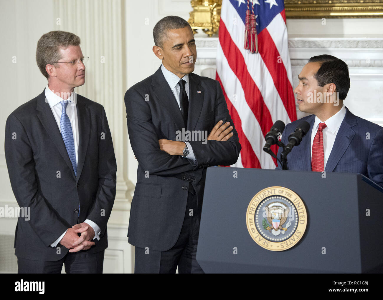 Washington, District of Columbia, USA. 23rd May, 2014. United States President Barack Obama, center, announces his nomination of current Housing and Urban Development (HUD) Secretary Shaun Donovan, left, as Office of Management and Budget (OMB) Director and his nomination of San Antonio Mayor Julián Castro, right, to replace him at HUD in the State Dining Room of the White House in Washington, DC on Friday, May 23, 2014 Credit: Ron Sachs/CNP/ZUMA Wire/Alamy Live News Stock Photo