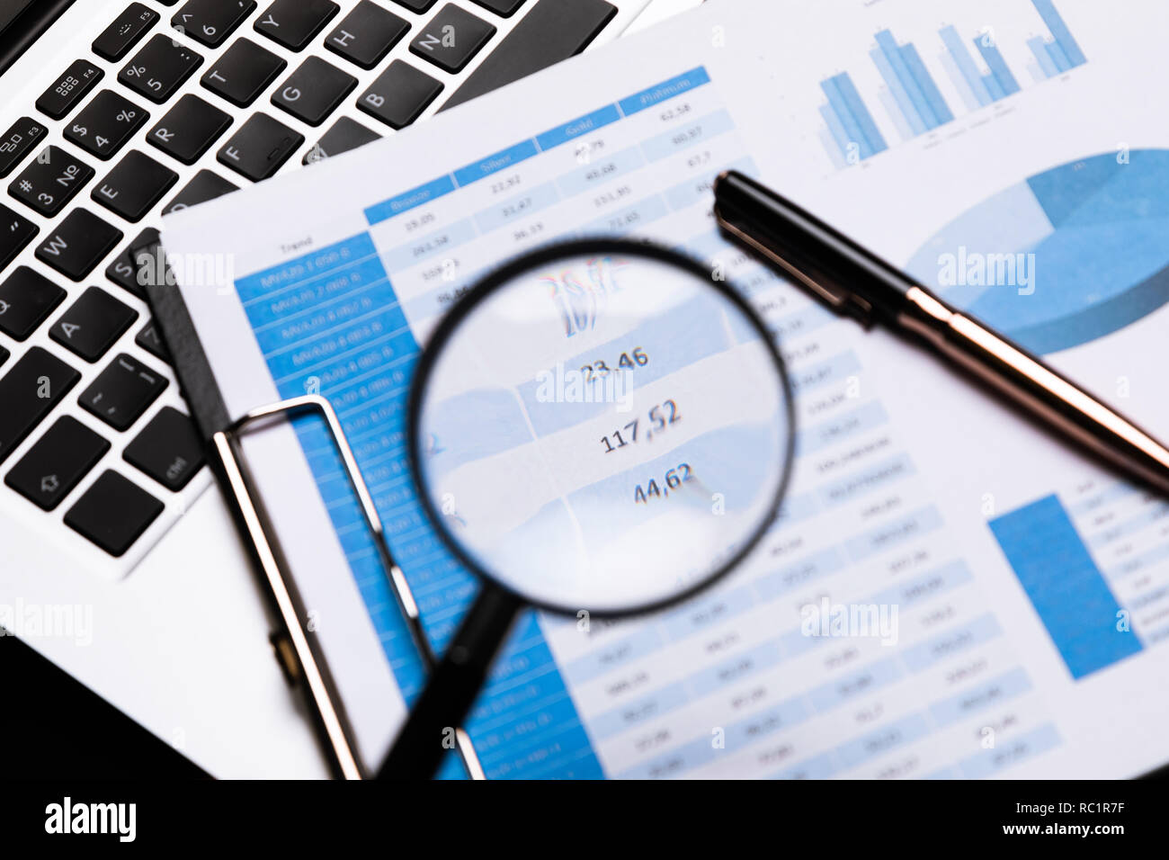 Office workplace with magnifier and stationery - Stock Image