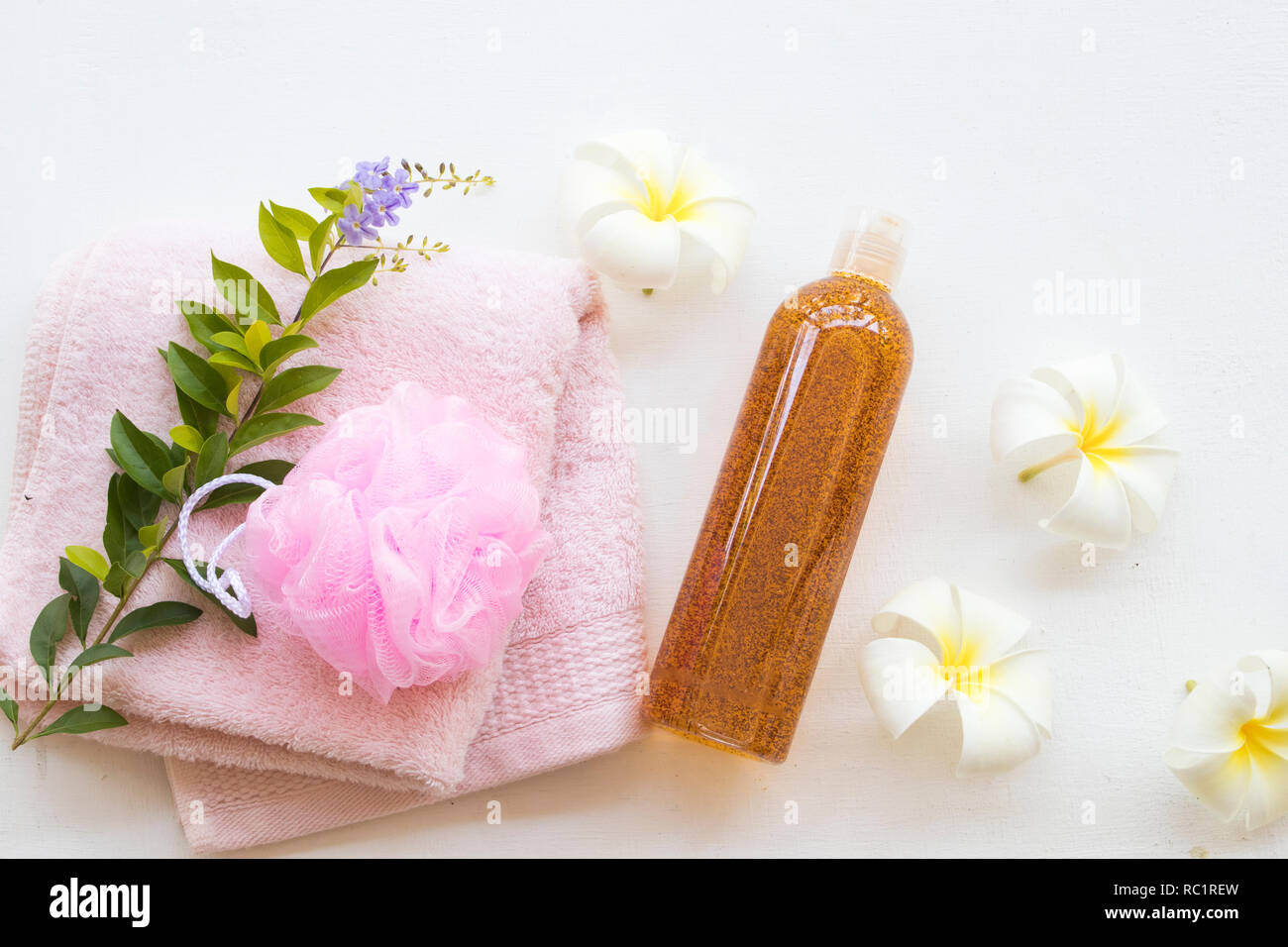 liquid soap exfoliating body wash smooth skin natural extract tamarind health care body skin with flowers frangipani - Stock Image