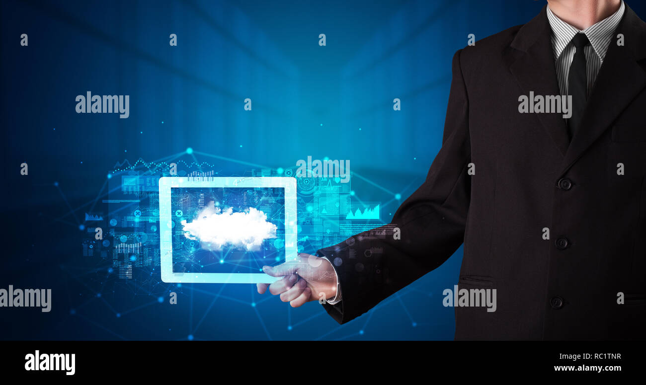 Hand holding tablet with cloud technology and dark concept  - Stock Image