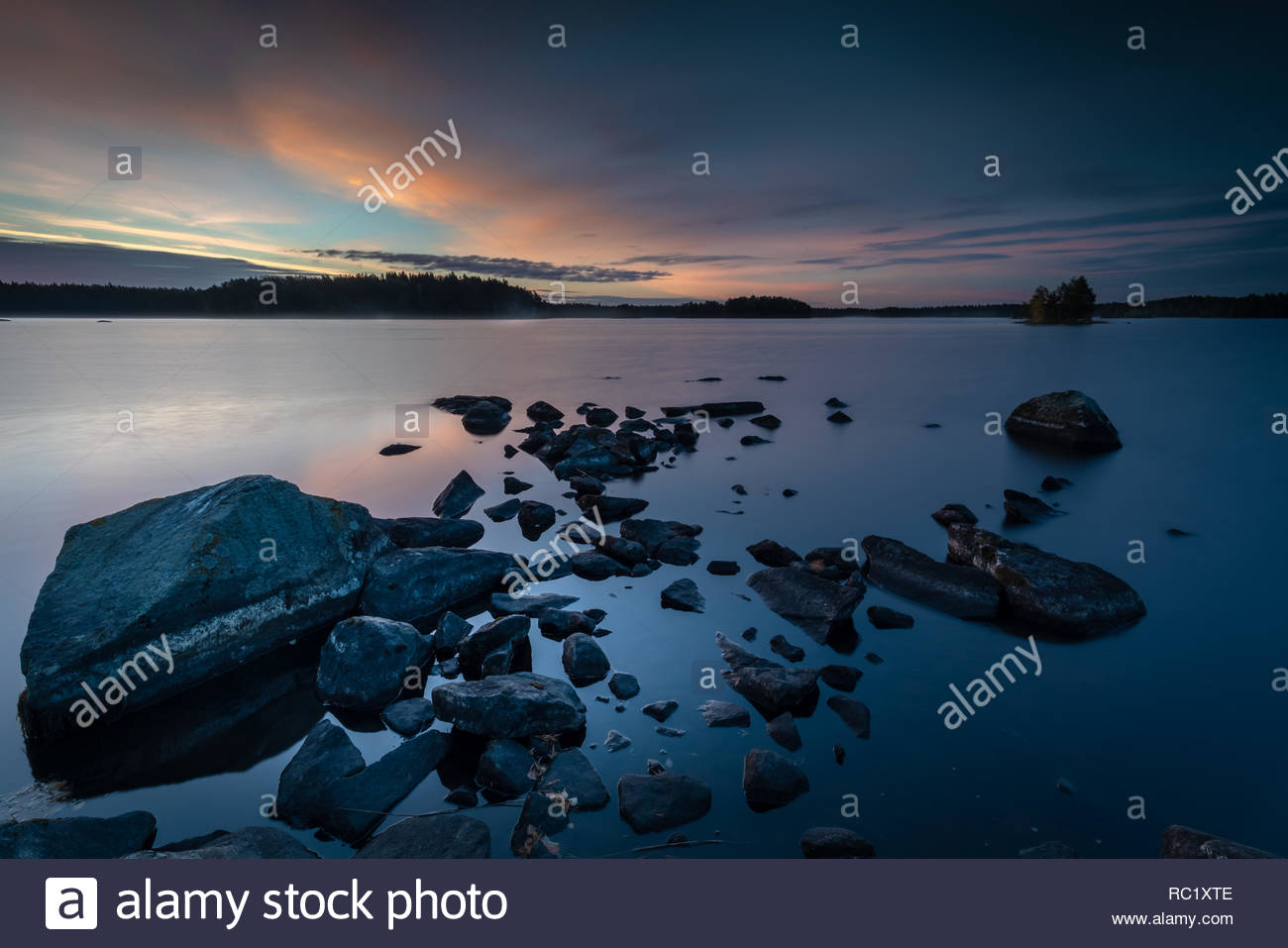 Dark scenic lake landscape, blue morning - Stock Image