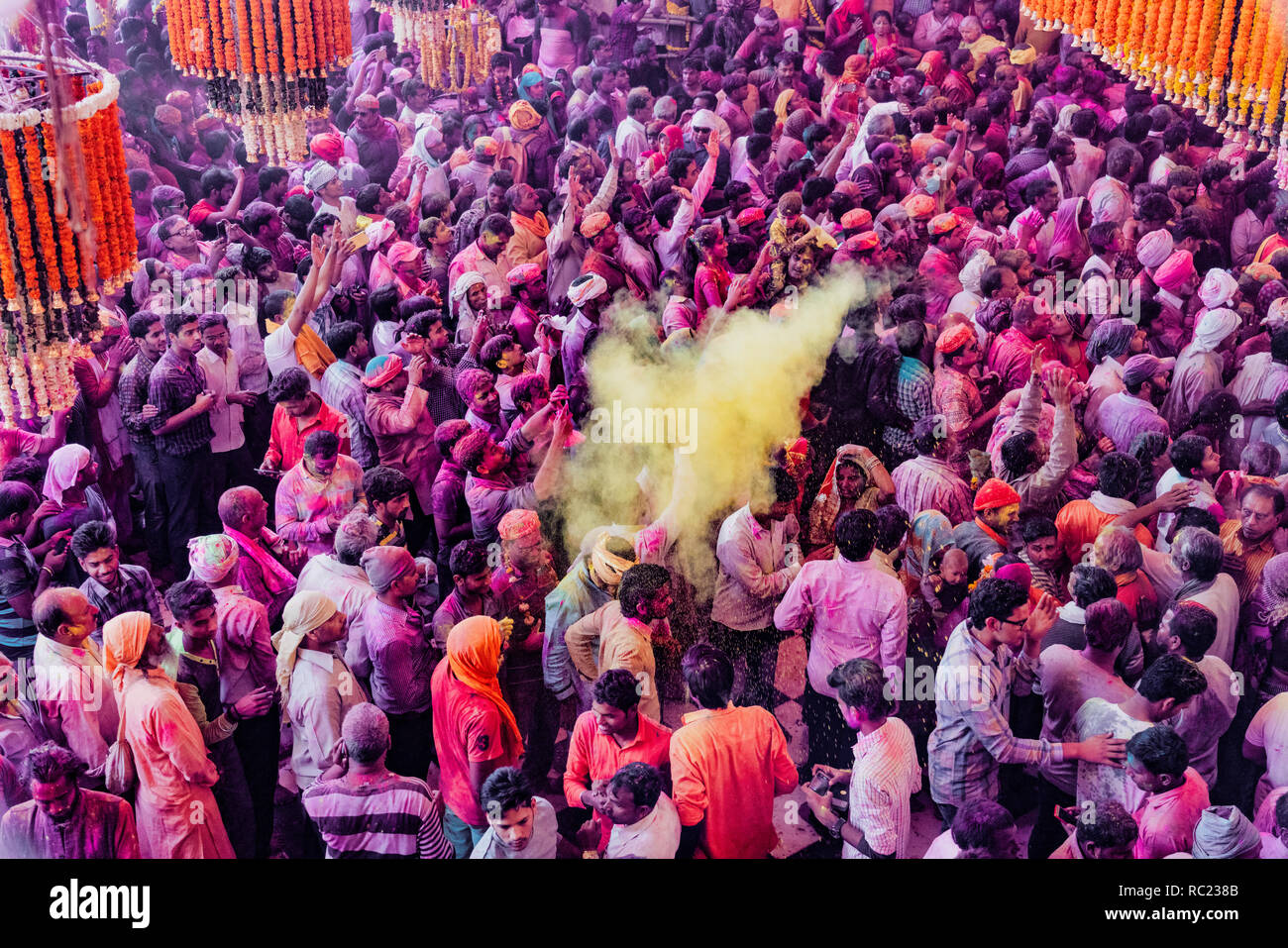Barsana, India / February 23, 2018 - Crowds pack tightly togerher as paint is thrown over their heads during Holi festival - Stock Image