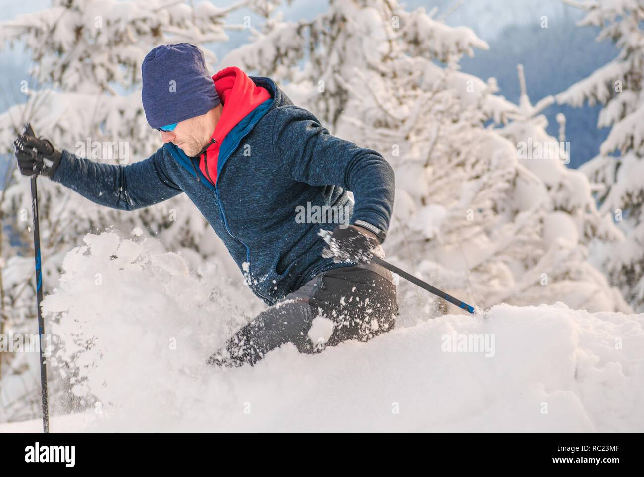 Backcountry Skier Ride in Heavy Snow. Off Piste Ski. Winter Sports Concept. - Stock Image