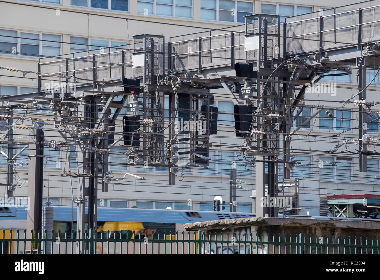 A complex array of cabling wiring and signals across multiple rail lines at the norther approach to Sydney's Central Railway Station in NSW Australia - Stock Image