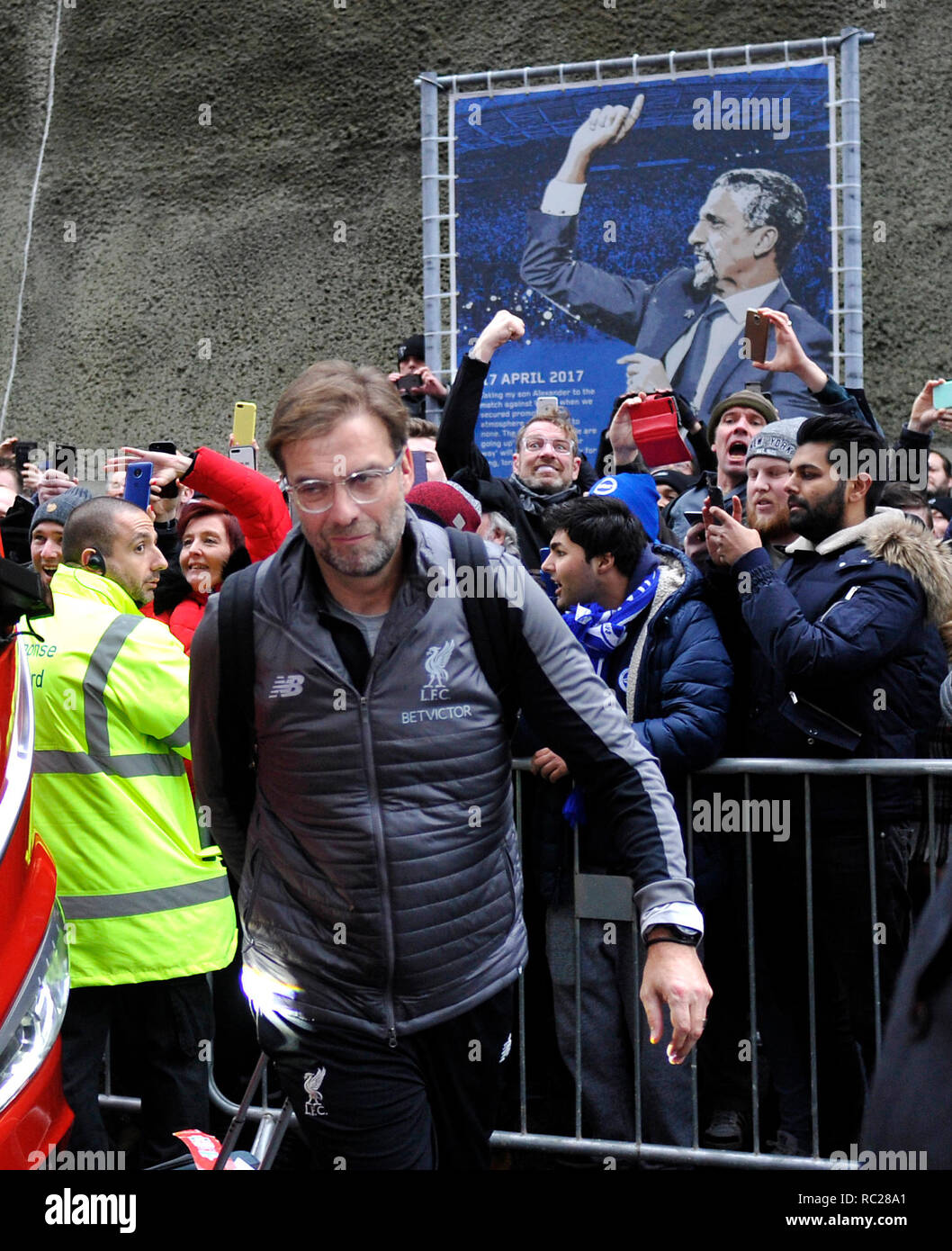 Liverpool manager Jurgen Klopp arrives with his lookalike behind for the Premier League match between  Brighton & Hove Albion and Liverpool at the American Express Community Stadium . 12 January 2019 Photograph taken by Simon Dack  Editorial use only. No merchandising. For Football images FA and Premier League restrictions apply inc. no internet/mobile usage without FAPL license - for details contact Football Dataco - Stock Image