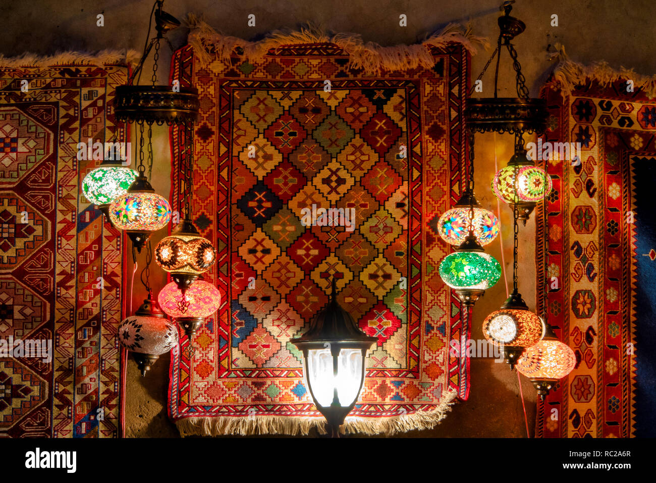 Turkish lamps and carpets on display in Icheri Sheher, Baku, Azerbaijan - Stock Image