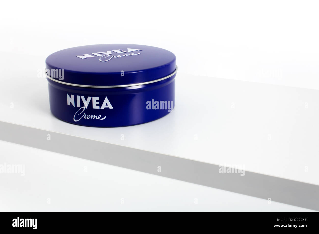 Prague, CZECH REPUBLIC - JANUARY 9, 2019: Nivea Creme 400ml, the world's famous skin cream skin cream in a metal jar laid on white shelf - Stock Image
