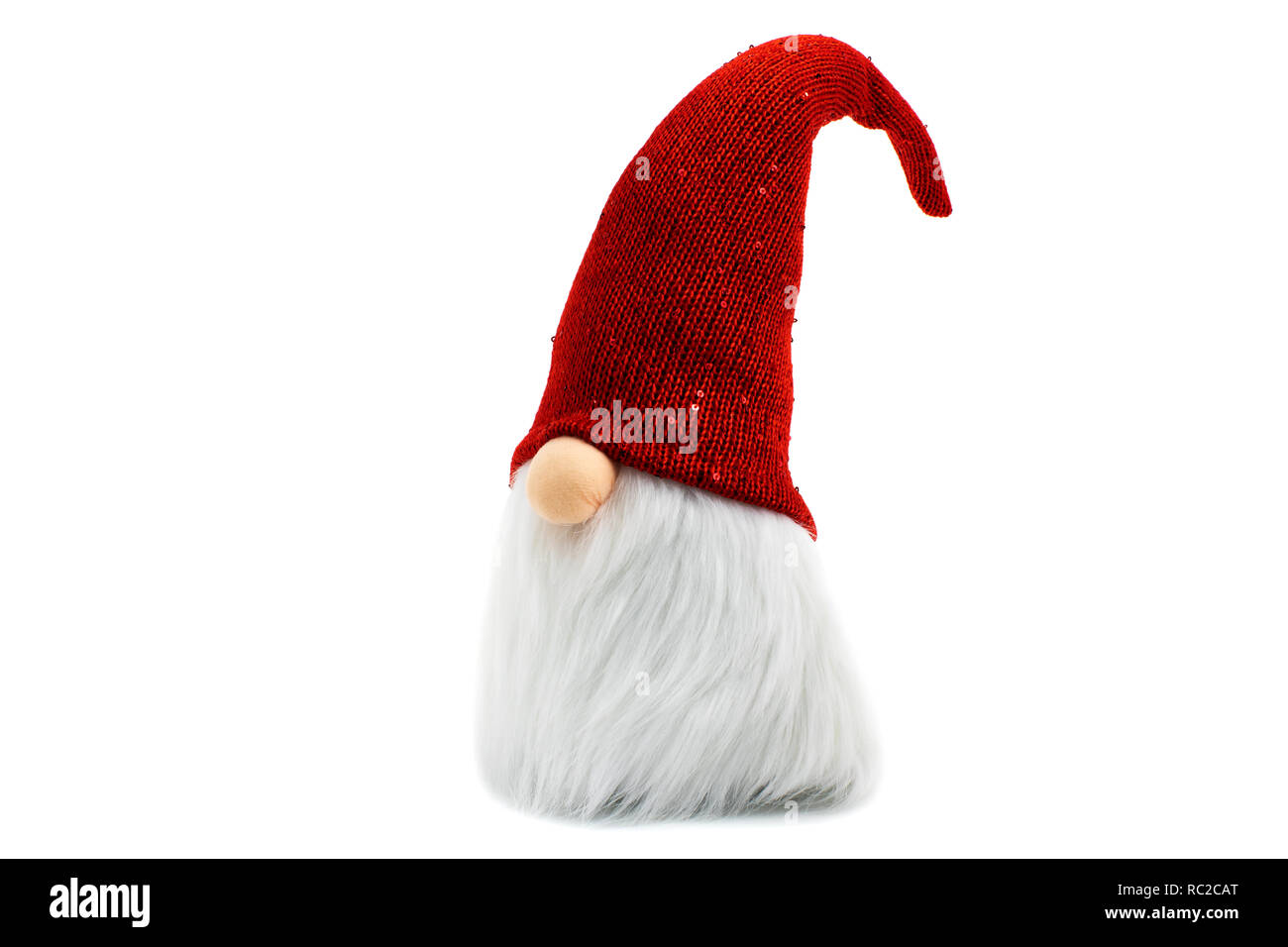Gnome a Christmas elf wearing big red with glitters hat and standing on white background - Stock Image