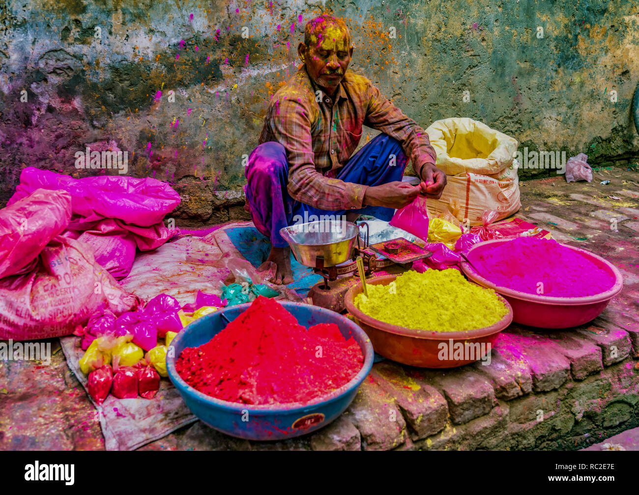 Barsana, India / February 23, 2018 - A man sells paint powder to be thrown by revelers during Holi festival - Stock Image