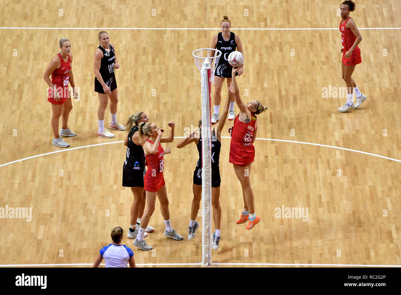 England Roses' Jo Harten scores during the Vitality Netball International Series match at the Echo Arena, Liverpool. - Stock Image