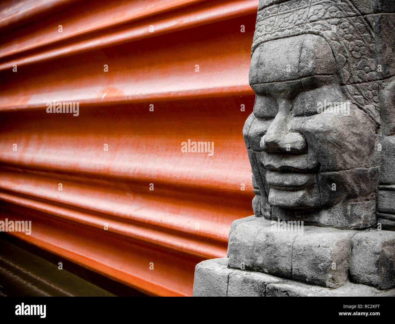 The ancient sandstone sculpture, The decor of the hotel building - Stock Image