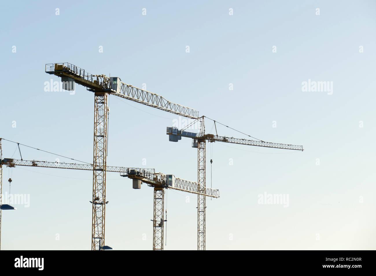 Construction cranes in Bremen's Überseestadt, Bremen, Germany, Europe - Stock Image
