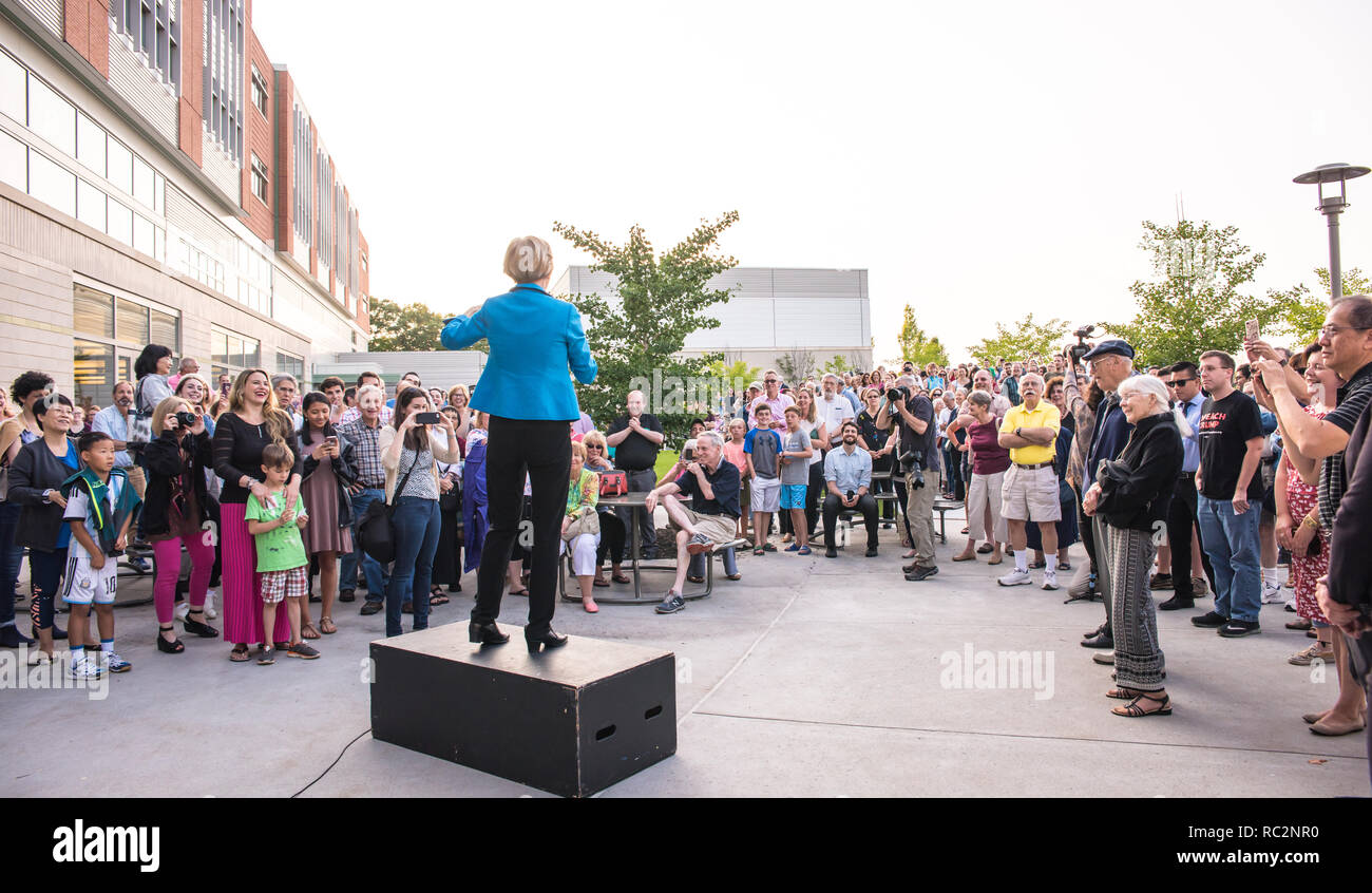 US Senator Elizabeth Warren standing on a podium and speaking to crowd that's gathered around her before her Town Hall at Concord-Carlisle Highschool. Stock Photo