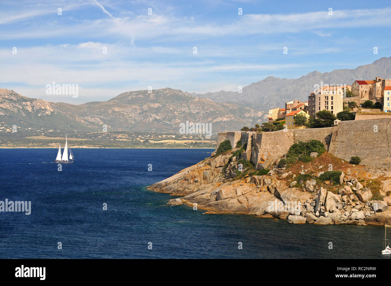 A lonely yacht approaching from the Golfe De Corsica - Stock Image