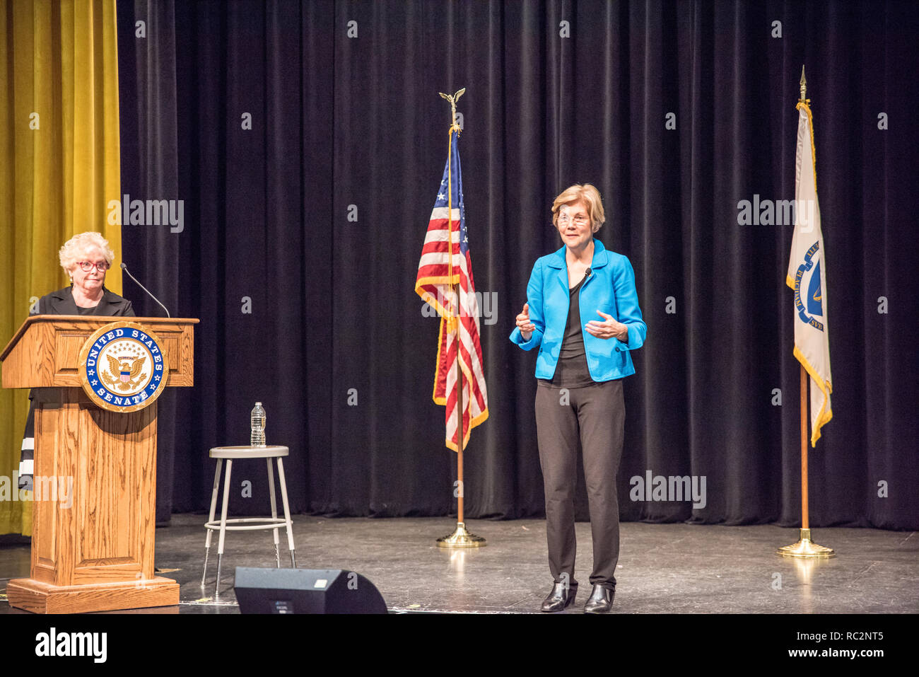 U.S. Senator Elizabeth Warren on stage with Massachusetts Representative Cory Atkins. - Stock Image
