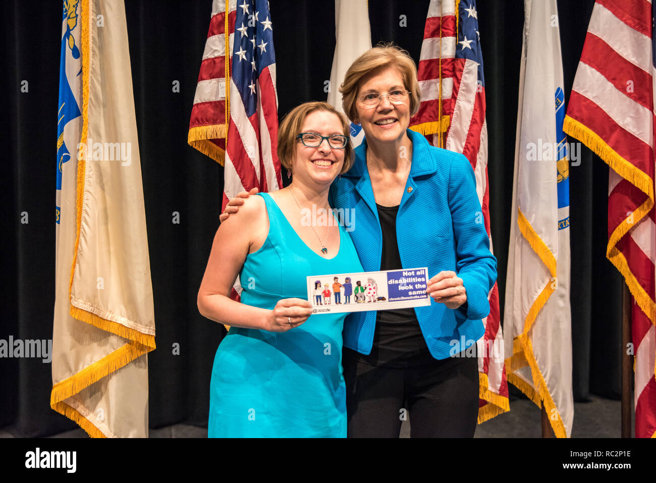 U.S. Senator Elizabeth Warren posing with a supporter and helping hold a sign about Disabilities after her Town Hall speech. - Stock Image