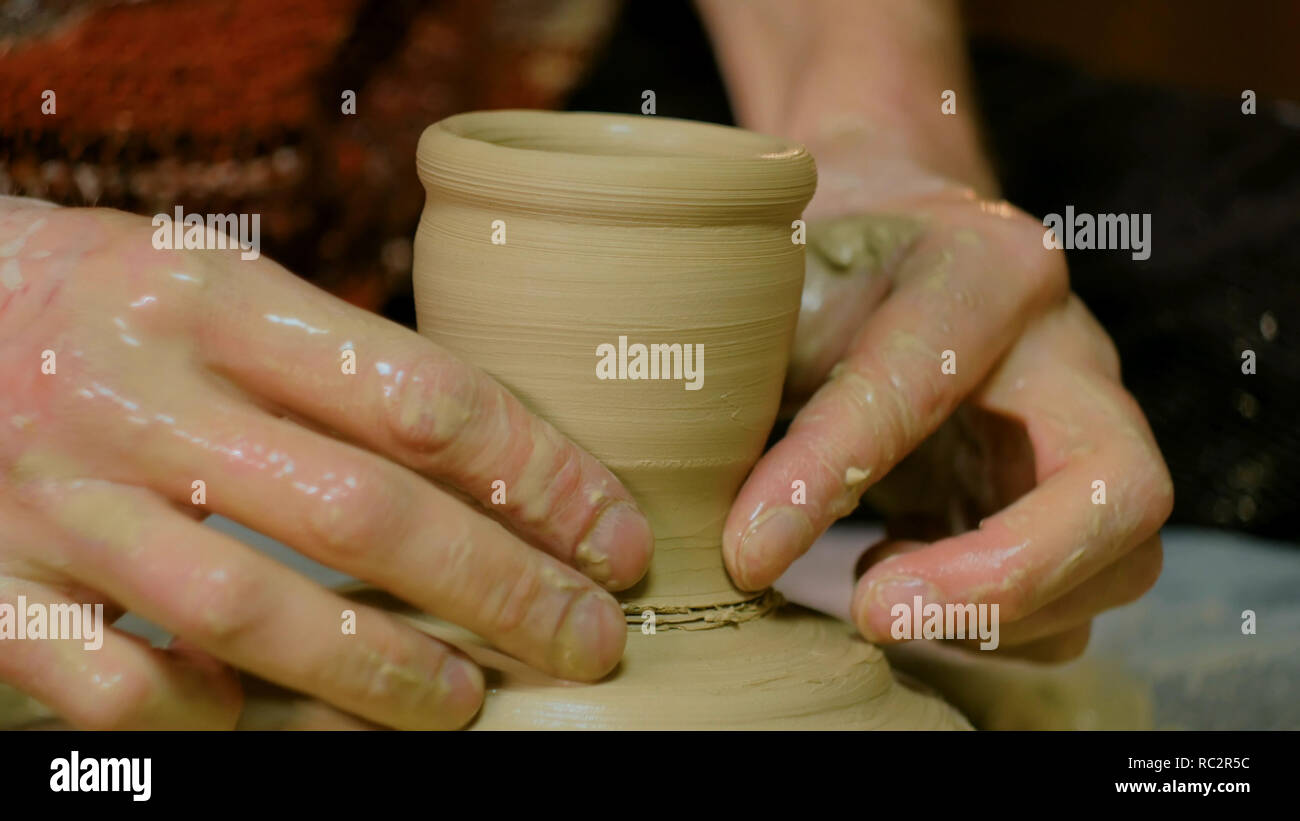 Professional male potter working in workshop, studio. Handmade, small business, crafting work concept - Stock Image