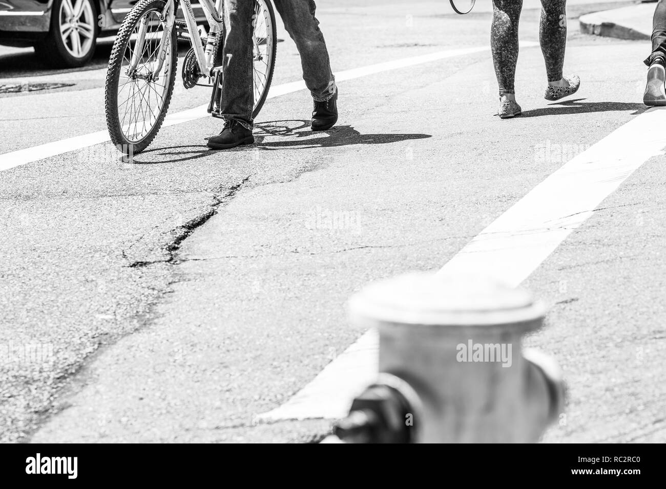 Pedestrians crossing a street in North Beach district, San Francisco, California - Stock Image