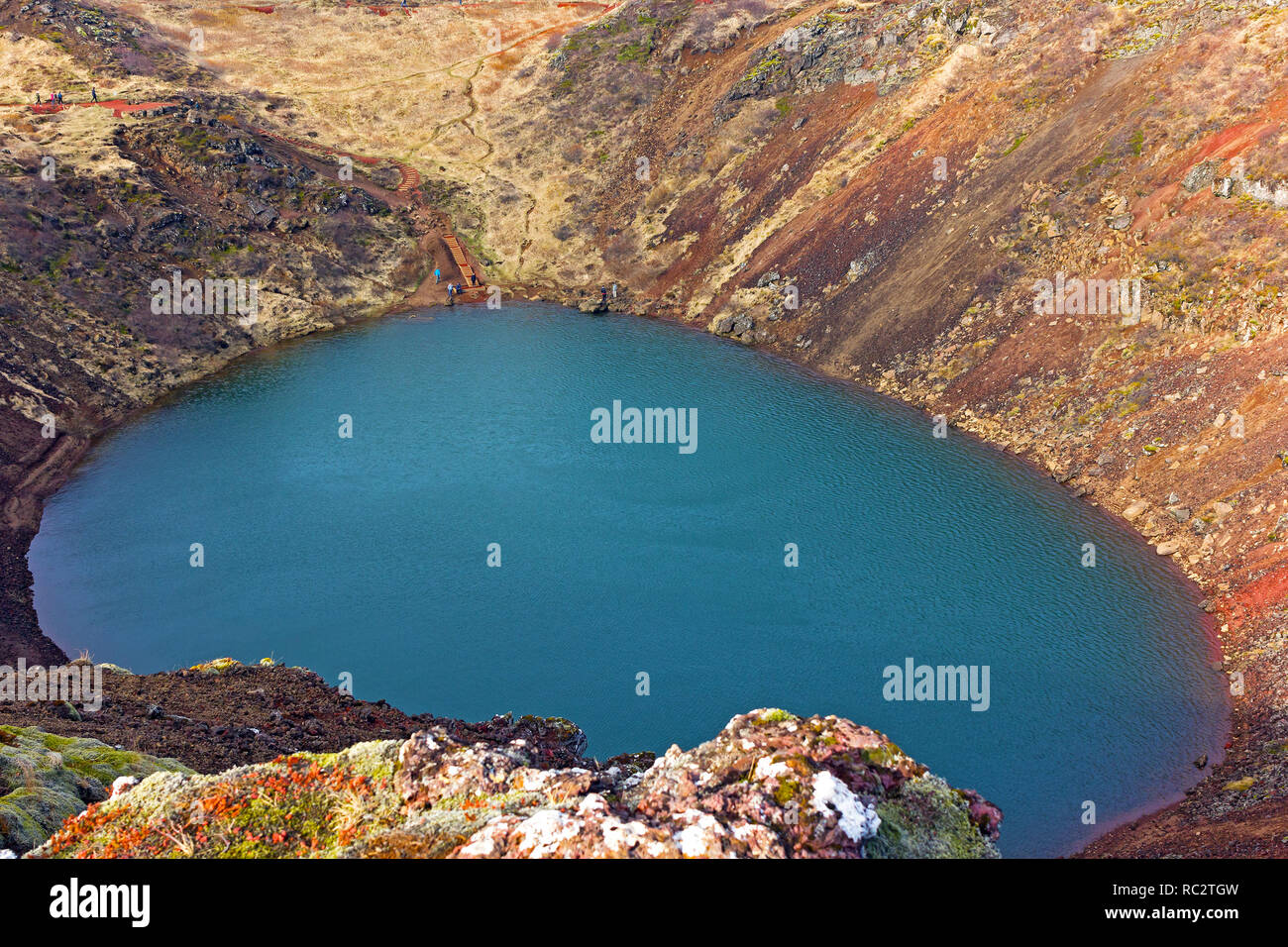 Tourists visit a volcanic crater lake in Iceland. The lake located in south Iceland, in Grimsnes along the Golden Circle. - Stock Image