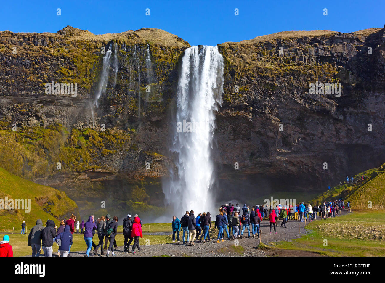 Overcrowded tourist destinations – at Skogafoss waterfall in South Iceland. Over-tourism is a new emerging trend. - Stock Image