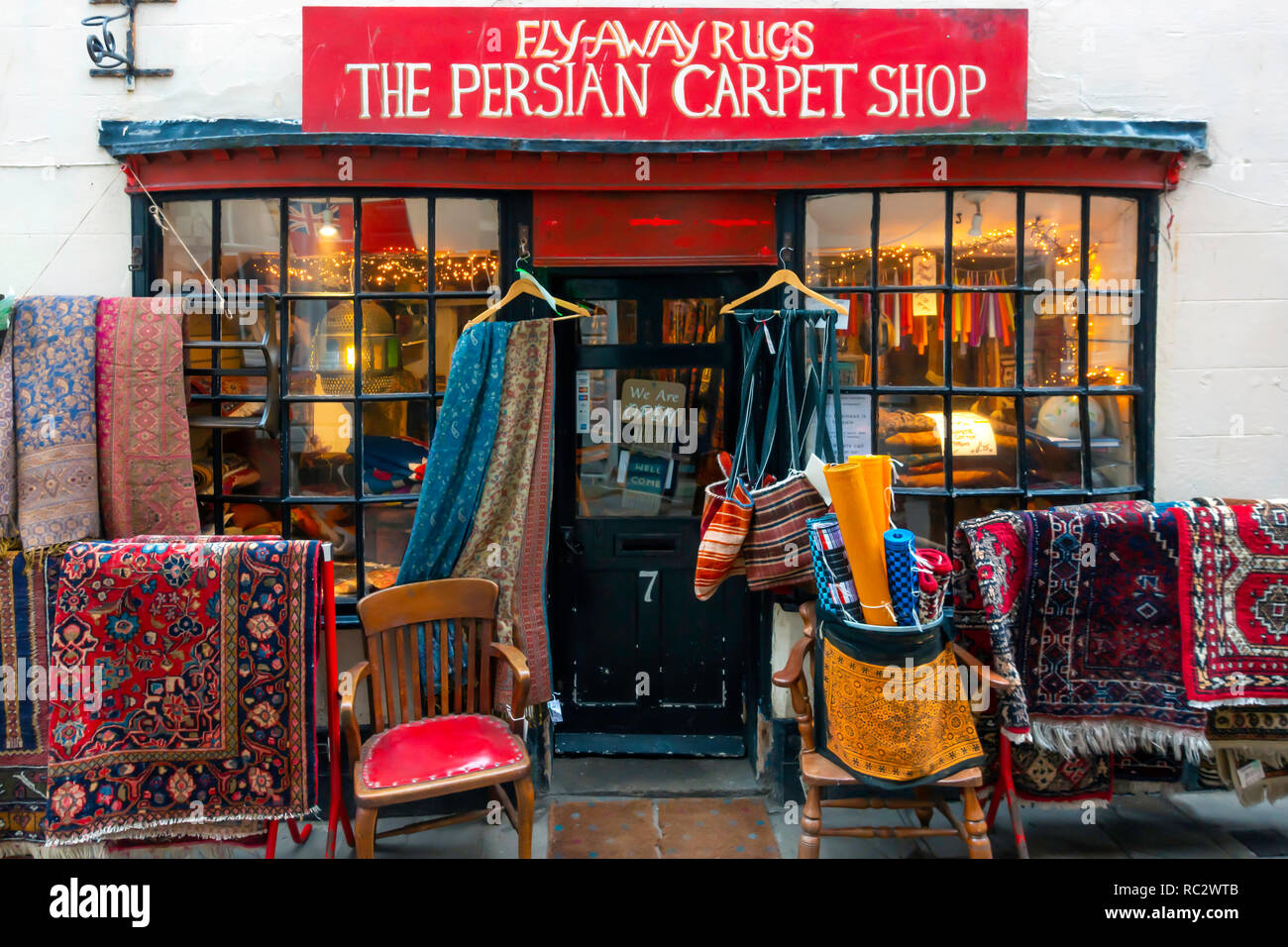 Fly away Rugs a shop selling Persian, Arabic and Middle Eastern carpets rugs and bags in Whitby North Yorkshire UK - Stock Image