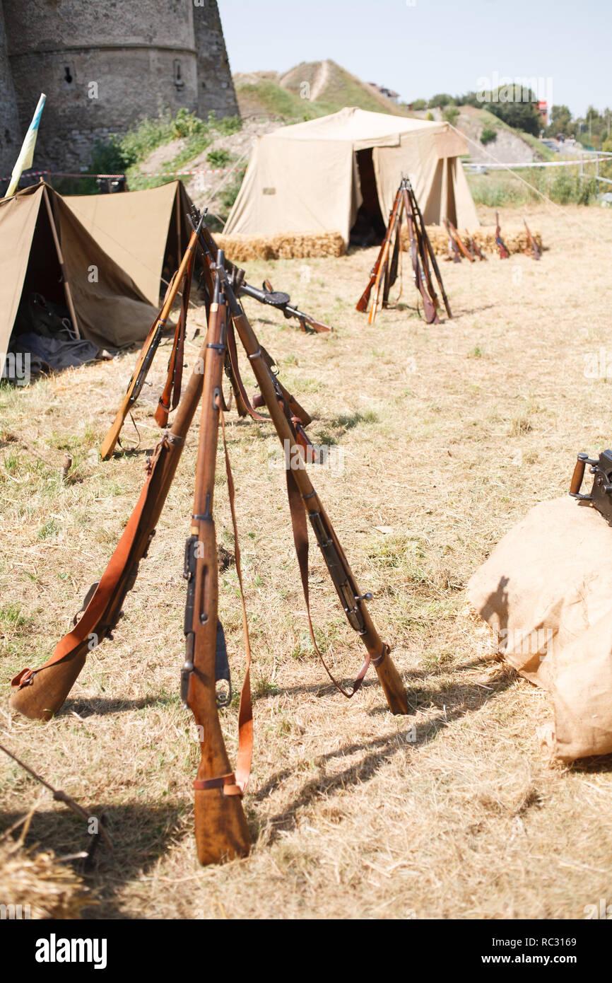 Rifles pyramids with ammunition, First World War-era reenactment - Stock Image