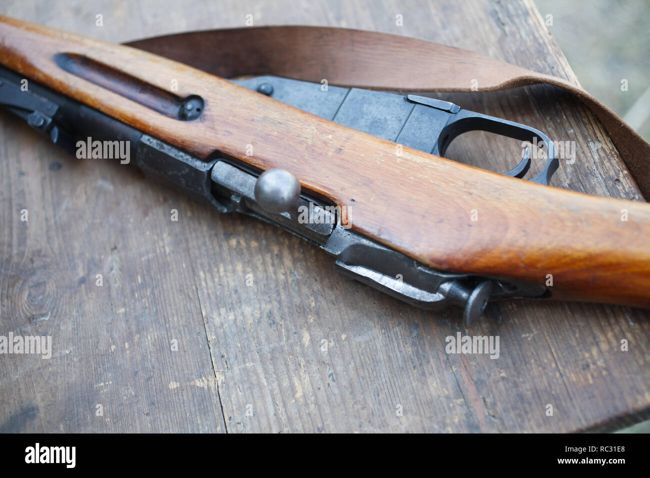 Russian Army Rifles on wooden desk, First World War-era reenactment - Stock Image