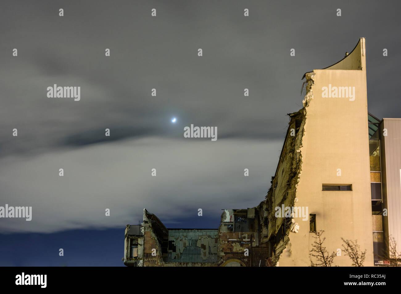 Wien, Vienna: ruin of no longer needed cinema in demolition, moon in 22. Donaustadt, Wien, Austria - Stock Image