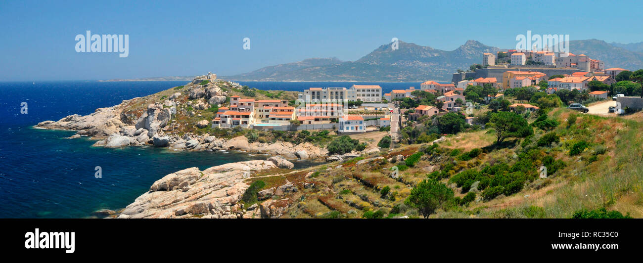 A view across a headland to the magnificent Citadel of Calvi. - Stock Image