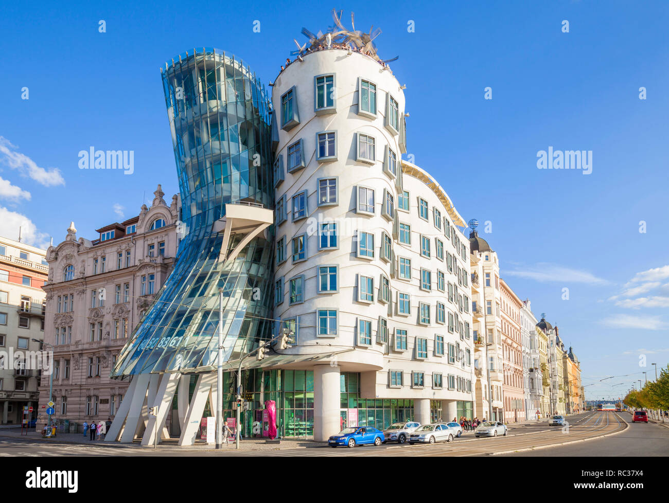 People in the roof cafe Prague Dancing House Prague or Ginger and Fred, Tančící dům, by Frank Gehry  and Vlado Milunic Czech Republic, EU Europe - Stock Image