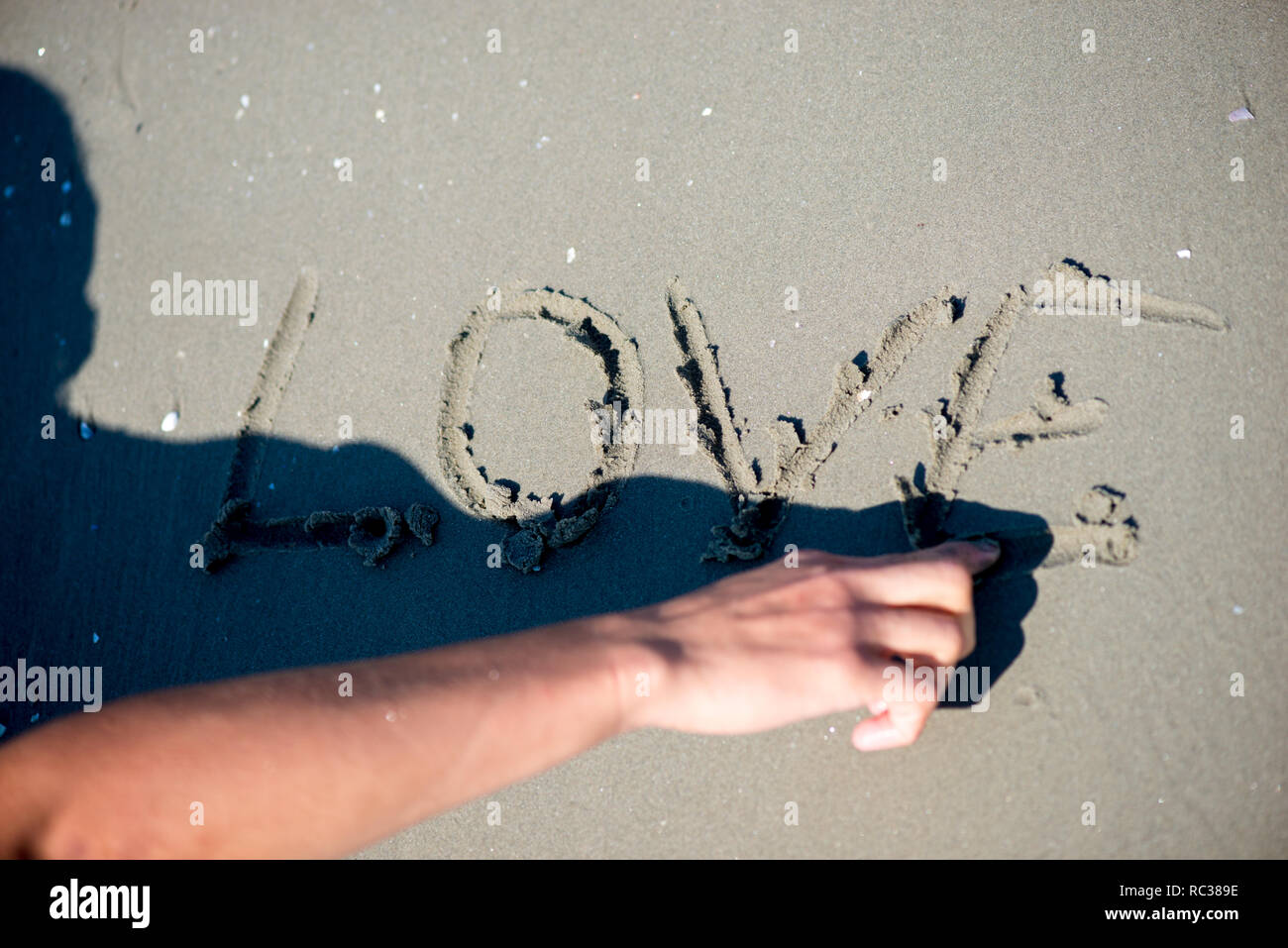 love message written in sand - Stock Image