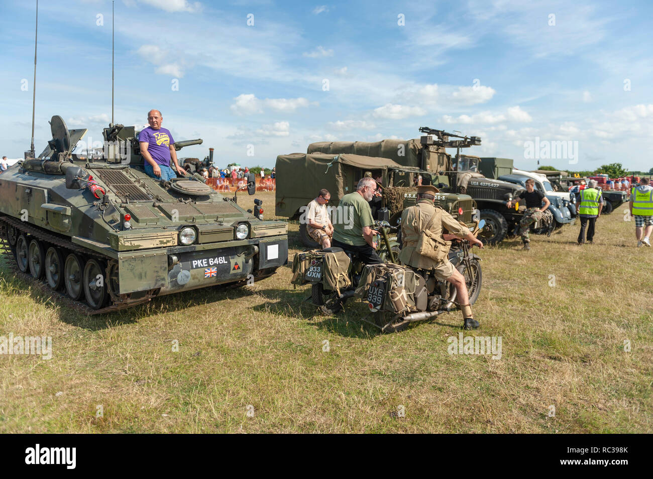 Two vintage British Army Matchless G3 350cc motorcycles and a 1970s FV103 Spartan armoured personnel carrier at Preston Steam Rally, Kent, England - Stock Image