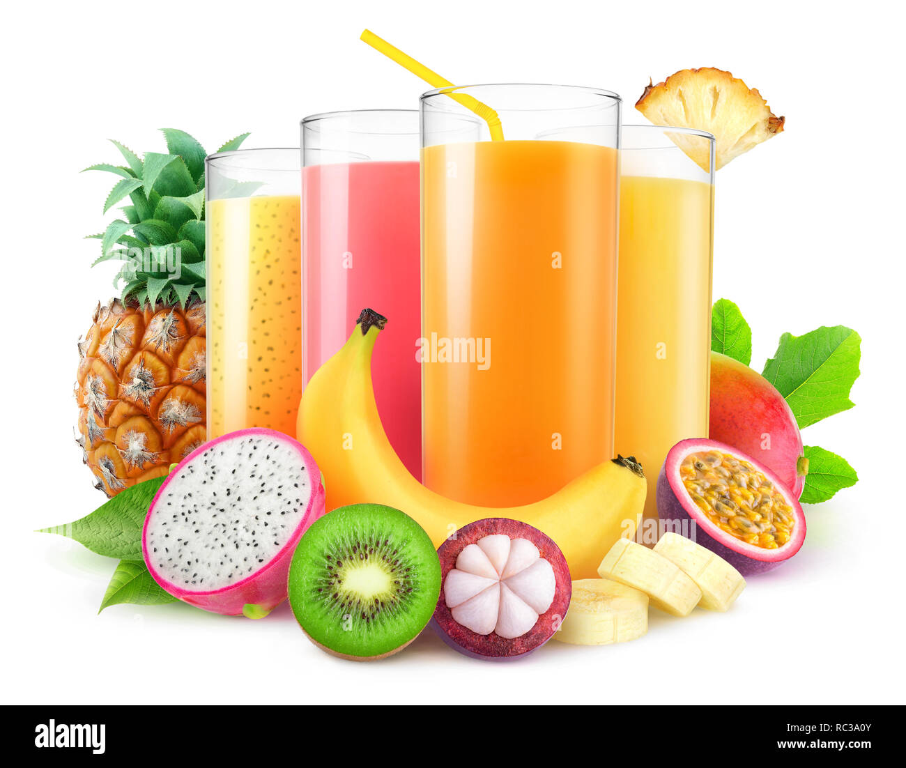 Isolated juices. Glasses of fresh juice and pile of tropical fruits isolated on white background with clipping path Stock Photo