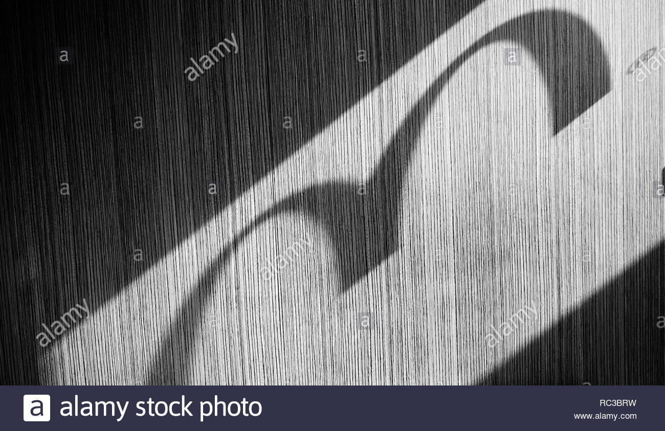 Rome, September 10, 2018: shadow of the McDonalds logo projected on wall, in the morning sun - Stock Image