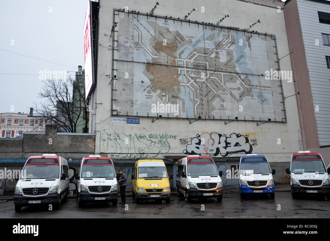 A map of Riga above marshrutka (shared taxis) parked at a central bus station, Riga, Republic of Latvia, Baltics, December 2018 Stock Photo