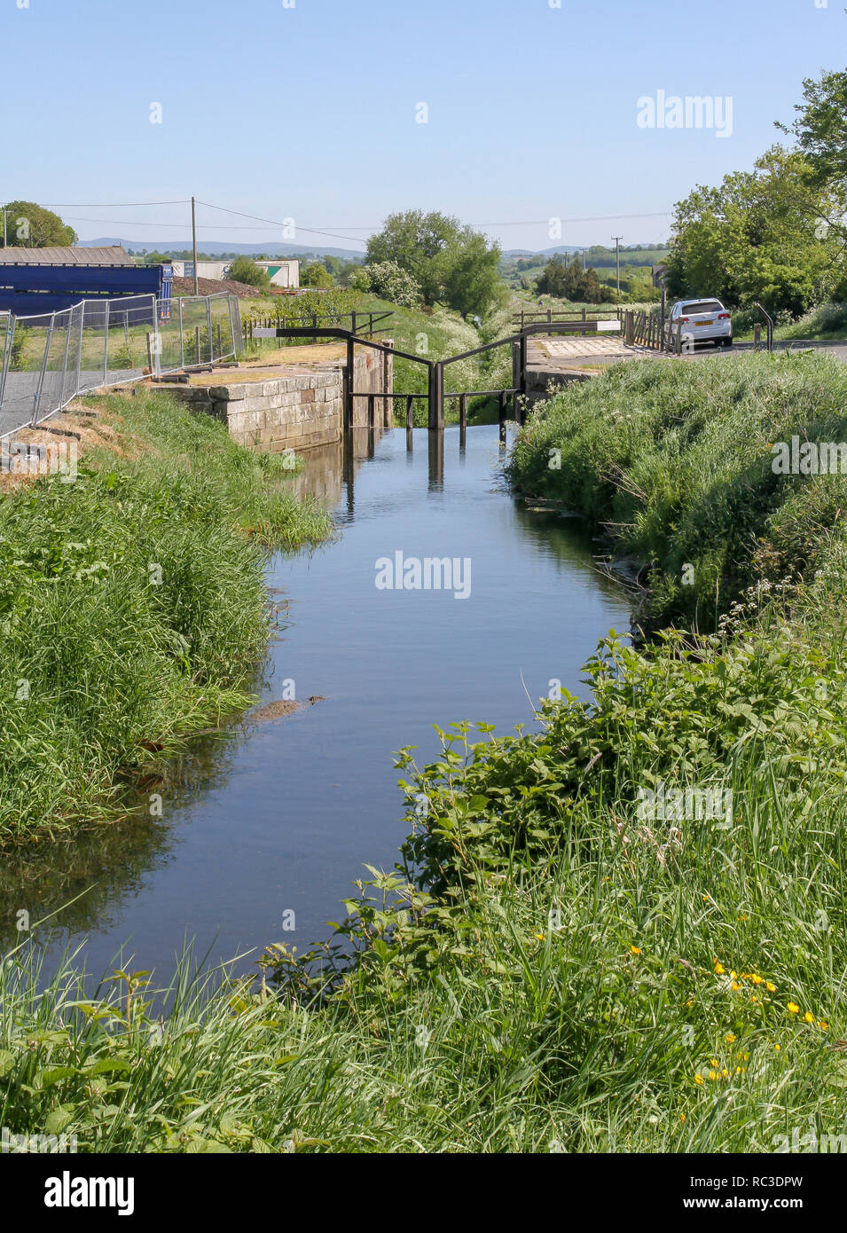 Overgrown canal and former canal lock on the Newry Canal at Poyntzpass County Down, Northern Ireland. - Stock Image