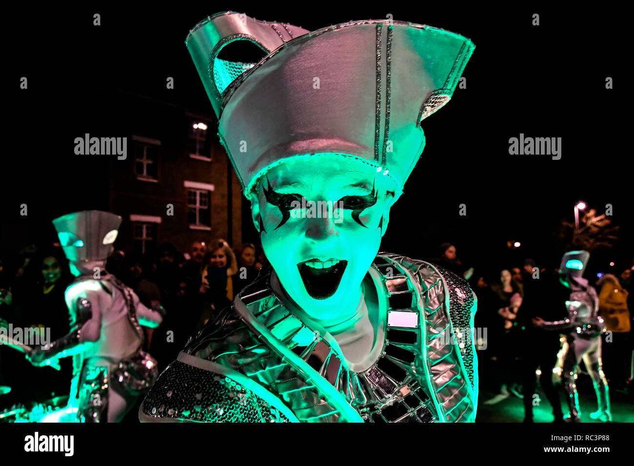 London, UK. 13th January 2019. Local community attends 'Welcome to the Forest' with spectacular paraders with a amazing lights dress, drums and gorgeous samba dancers at Forest Road, Walthamstow on 13 January 2019, London, UK. Credit: Picture Capital/Alamy Live News - Stock Image