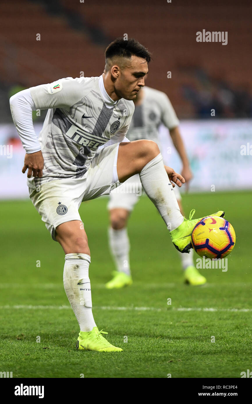 Milan, Italy. 13th Jan 2019. Forward Lautaro Martínez (Inter) controls the ball during the Italian Cup 'Coppa Italia' football match, Inter Milan vs Benevento Calcio at San Siro Meazza Stadium in Milan, Italy on 13 January 2019. The football match is played behind closed doors after Napoli's Senegalese player Kalidou Koulibaly was subject to racist chants by FC Internazionale's 'ultra' fans during the Boxing Day match. Credit: Piero Cruciatti/Alamy Live News - Stock Image