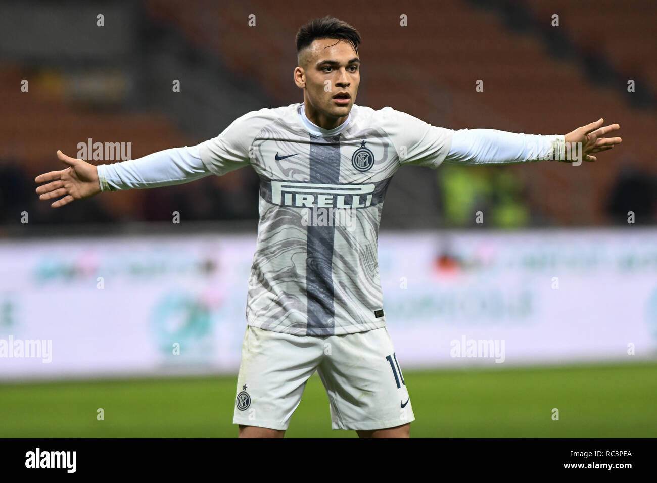 Milan, Italy. 13th Jan 2019. Forward Lautaro Martínez (Inter) gestures during the Italian Cup 'Coppa Italia' football match, Inter Milan vs Benevento Calcio at San Siro Meazza Stadium in Milan, Italy on 13 January 2019. The football match is played behind closed doors after Napoli's Senegalese player Kalidou Koulibaly was subject to racist chants by FC Internazionale's 'ultra' fans during the Boxing Day match. Credit: Piero Cruciatti/Alamy Live News Stock Photo