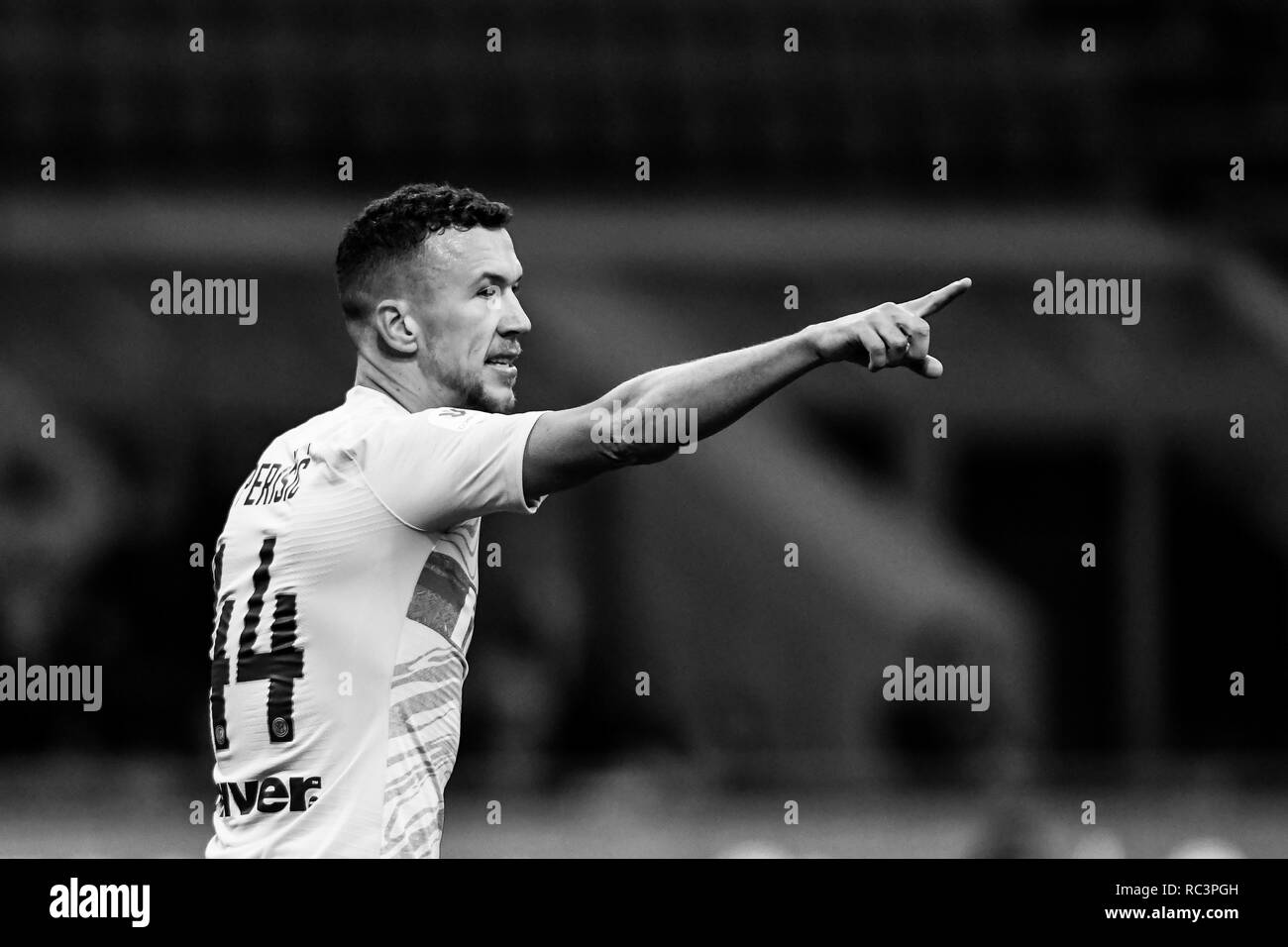 Black and White image of Midfielder Ivan Perisic (Inter) gesturing during the Italian Cup 'Coppa Italia' football match, Inter Milan vs Benevento Calcio at San Siro Meazza Stadium in Milan, Italy on 13 January 2019. The football match is played behind closed doors after Napoli's Senegalese player Kalidou Koulibaly was subject to racist chants by FC Internazionale's 'ultra' fans during the Boxing Day match. Credit: Piero Cruciatti/Alamy Live News - Stock Image