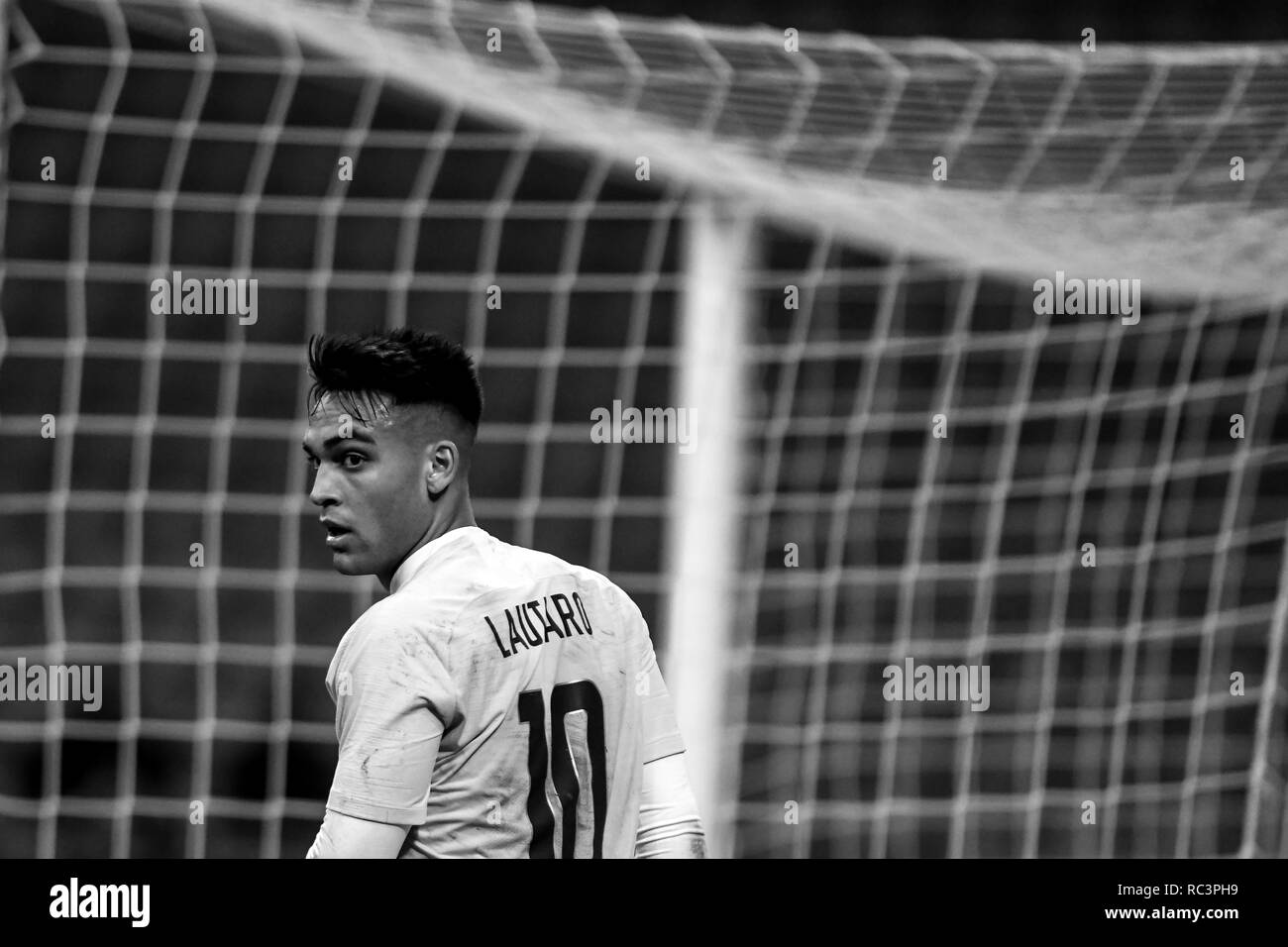 Black and White image of Forward Lautaro Martínez (Inter) looking on during the Italian Cup 'Coppa Italia' football match, Inter Milan vs Benevento Calcio at San Siro Meazza Stadium in Milan, Italy on 13 January 2019. The football match is played behind closed doors after Napoli's Senegalese player Kalidou Koulibaly was subject to racist chants by FC Internazionale's 'ultra' fans during the Boxing Day match. Credit: Piero Cruciatti/Alamy Live News Stock Photo